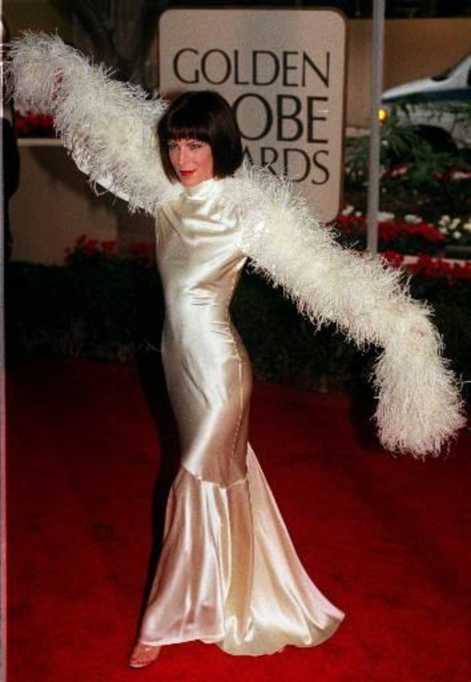 "Actress Lara Flynn Boyle of the television drama ""The Practice,""  shows off her outfit at the arrivals of the 56th Annual Golden Globe Awards, Sunday, Jan. 24, 1999, at the Beverly Hilton in Beverly Hills, Calif. (AP Photo/Chris Pizzello)"