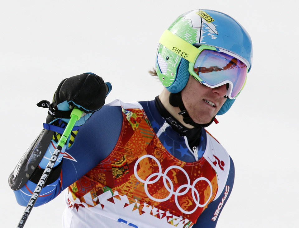 Photo - United States' Ted Ligety pauses after finishing  in the first run of the men's giant slalom at the Sochi 2014 Winter Olympics, Wednesday, Feb. 19, 2014, in Krasnaya Polyana, Russia. (AP Photo/Gero Breloer)