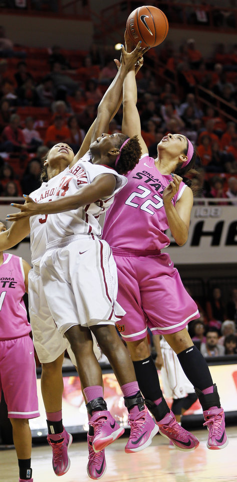Photo - From left, Oklahoma's Portia Durrett (31), Sharane Campbell (24) and Oklahoma State's Brittney Martin (22) try to rebound the ball in the second half during the women's Bedlam college basketball game between the OU Sooners and the OSU Cowgirls at Gallagher-Iba Arena in Stillwater, Okla., Sunday, Feb. 16, 2014. OSU won, 73-57. Photo by Nate Billings, The Oklahoman