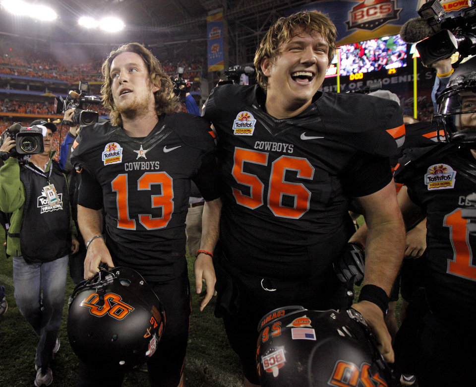 Photo - Oklahoma State's Quinn Sharp (13) celebrates with Connor Sinko (56) after winning the Fiesta Bowl between the Oklahoma State University Cowboys (OSU) and the Stanford Cardinal at the University of Phoenix Stadium in Glendale, Ariz., Tuesday, Jan. 3, 2012. Photo by Bryan Terry, The Oklahoman
