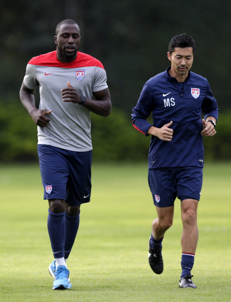Photo - United States' Jozy Altidore, left, works out with trainer Masa Sakihana during a training session in Sao Paulo, Brazil, Saturday, June 28, 2014. The U.S. will play against Belgium in the round 16 of the 2014 soccer World Cup. (AP Photo/Julio Cortez)