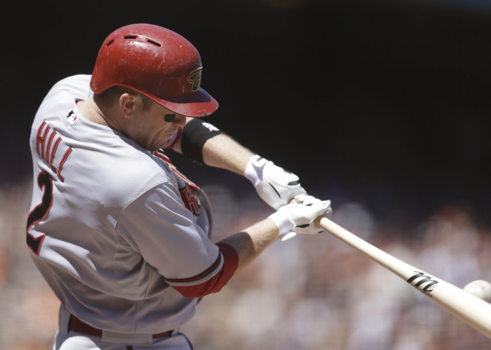Photo - Arizona Diamondbacks' Aaron Hill swings for a double off San Francisco Giants' Ryan Vogelsong in the seventh inning of a baseball game Saturday, July 12, 2014, in San Francisco. (AP Photo/Ben Margot)