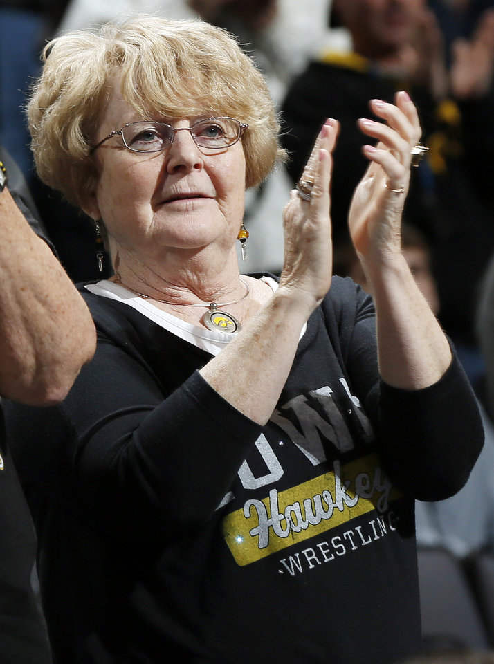 Photo - Bonnie Brands applauds as wrestlers are introduced during the 2014 NCAA Div. I Wrestling Championships at Chesapeake Energy Arena in Oklahoma City, Saturday, March 22, 2014. Photo by Nate Billings, The Oklahoman