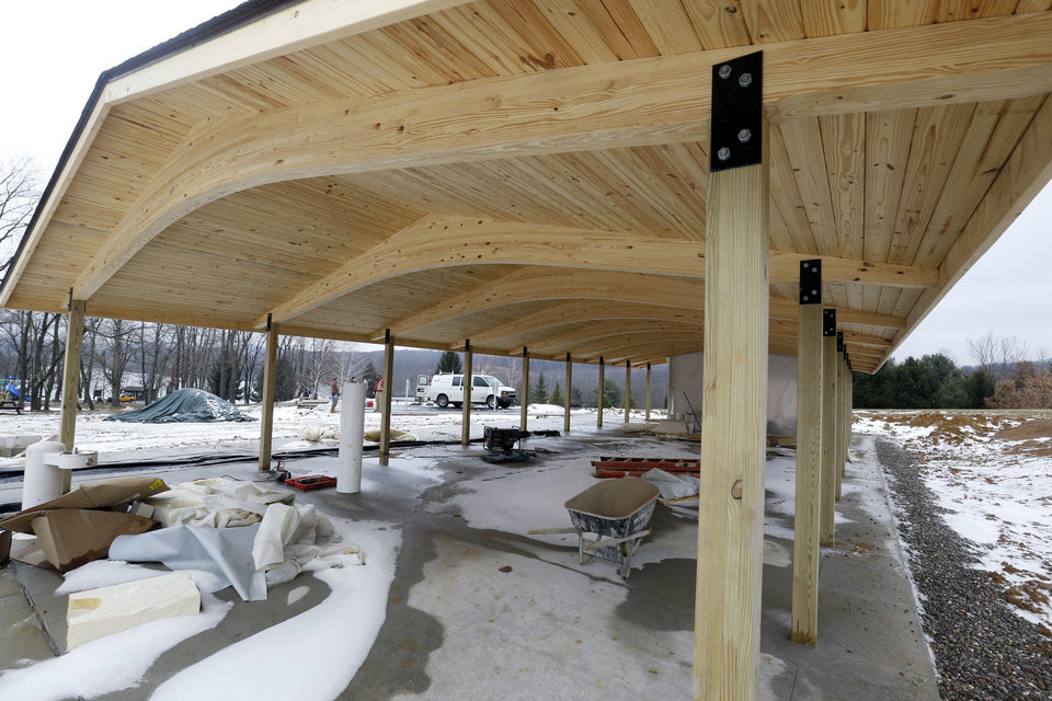 Photo - In this Friday, Jan. 10, 2014 photo, construction of the new shelter 3 building continues in Washington County's Cross Creek County Park in Avella, Pa. The building is being paid for from gas well royalties from wells under the park. Local officials say the deals have worked well, and that they have few other options to generate new funds. But some residents don't like drilling taking place under public land. (AP Photo/Keith Srakocic)