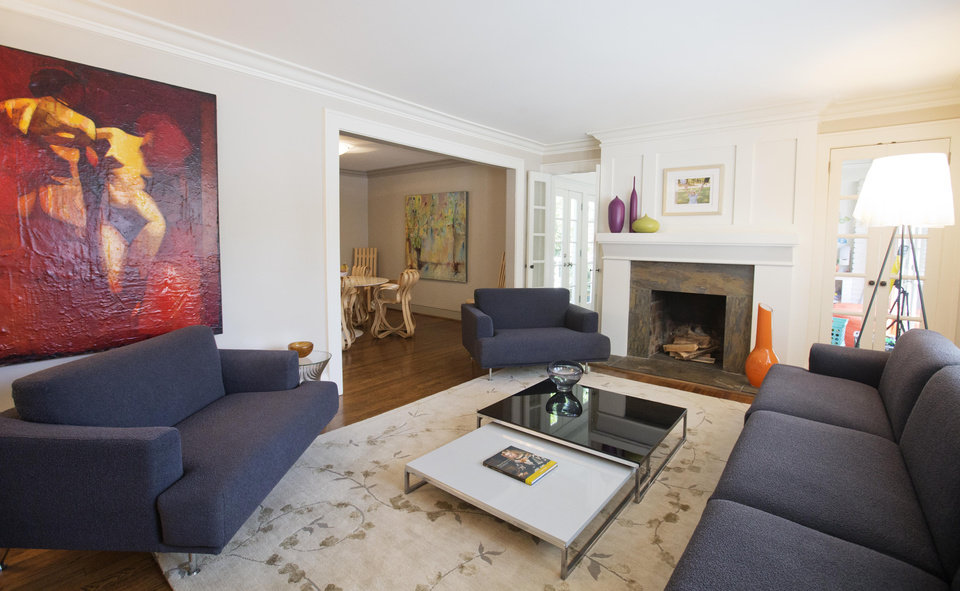 Photo - This is an interior view of the living room in a three bedroom house listed for sale at $1,095,000 on Wednesday, July 30, 2014, in the Sherwood Forest neighborhood of Atlanta. The 2,551-square-foot house has two and a half bathrooms and features an in-ground pool and garage. (AP Photo/David Goldman)