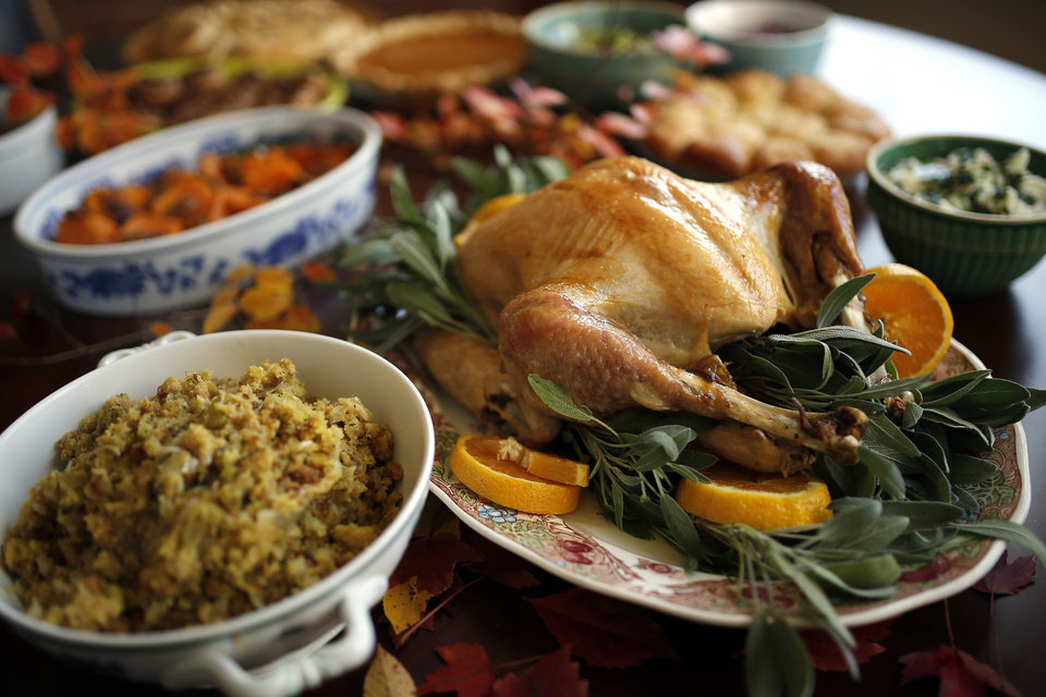 Photo - Turkey and dressing  portion of Thanksgiving dinner. Photo by Sarah Phipps, The Oklahoman