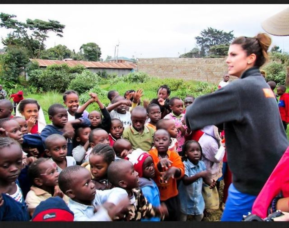 Photo -  Miss Oklahoma Alex Eppler, right, dances with children in Kenya. An aspiring physician's assistant, Eppler spent two weeks during summer, 2014, in Kenya volunteering with International Medical Relief. Photo provided.