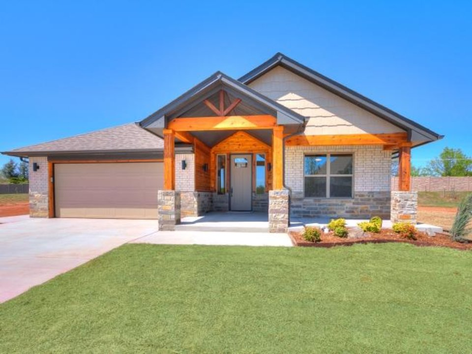 Photo -  This festival home at 2015 Turtle Creek Way in Norman was built by Armstrong Homes. [PHOTO PROVIDED BY BASCO]