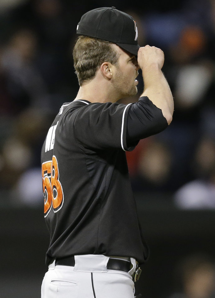 Miami Marlins closer Ryan Webb reacts after Chicago White Sox' Paul Konerko hit a single during the 11th inning of an interleague baseball game, Friday, May 24, 2013, in Chicago. The White Sox won 4-3. (AP Photo/Nam Y. Huh)