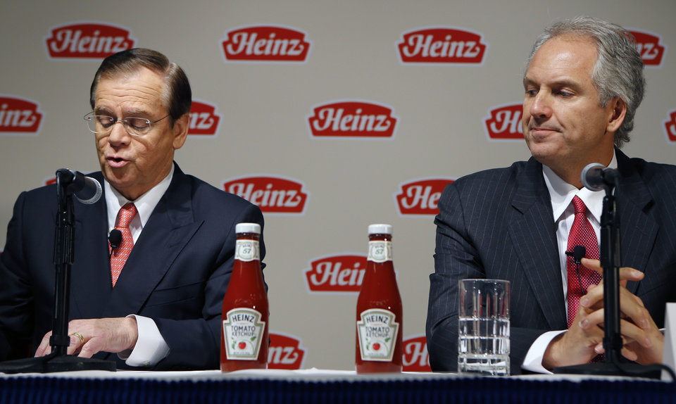 Photo - H.J. Heinz Co. CEO William Johnson, left, and 3G Capital Managing Partner Alex Behring speak at a news conference at the world headquarters of the H.J. Heinz Co. on Thursday, Feb. 14, 2013, in Pittsburgh. Billionaire investor Warren Buffett's Berkshire Hathaway and its partner on the deal. 3G Capital, are  dipping into the ketchup business as part of a $23.3 billion deal to buy the Heinz ketchup company. (AP Photo/Keith Srakocic)
