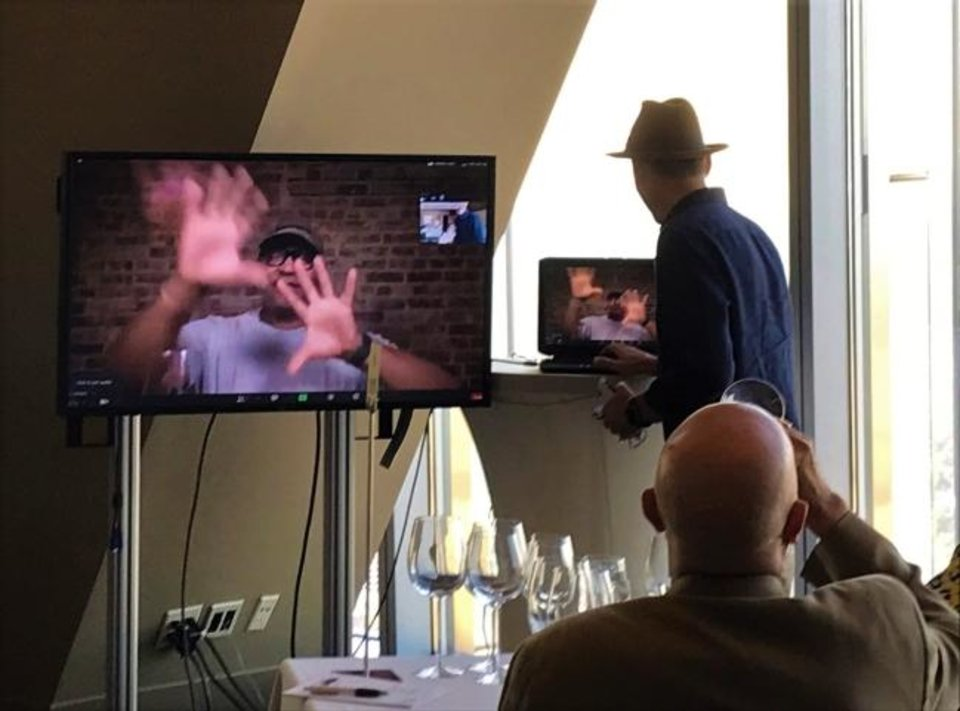 Photo -  Winemaker Andre Mack talks with his hands via live remote during a wine dinner at Vast in Oklahoma City. [Dave Cathey/The Oklahoman]