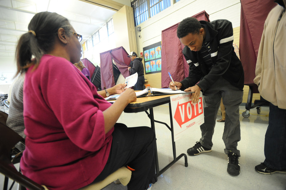 Photo -   Jerome Williams signs in as he prepares to vote in his first presidential election, Tuesday, Nov. 6, 2012 in Shreveport, La. (AP Photo/The ( Shreveport ) Times, Douglas Collier)
