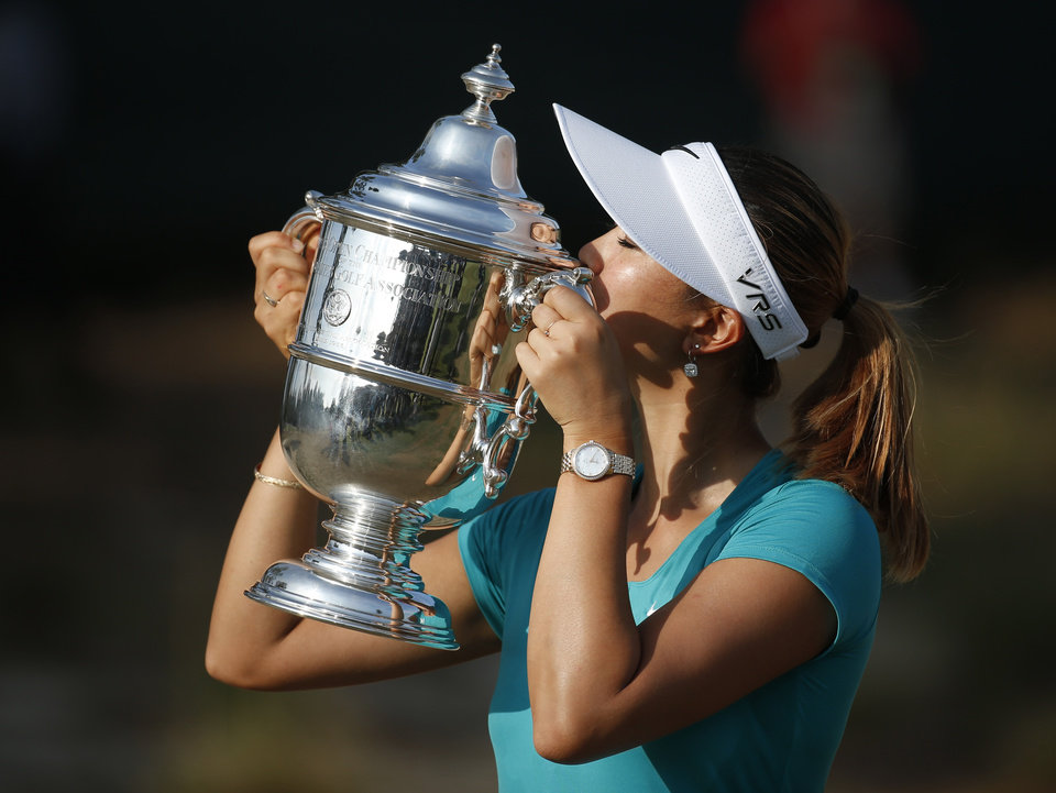 Photo - Michelle Wie kisses the trophy after winning the U.S. Women's Open golf tournament in Pinehurst, N.C., Sunday, June 22, 2014. (AP Photo/John Bazemore)