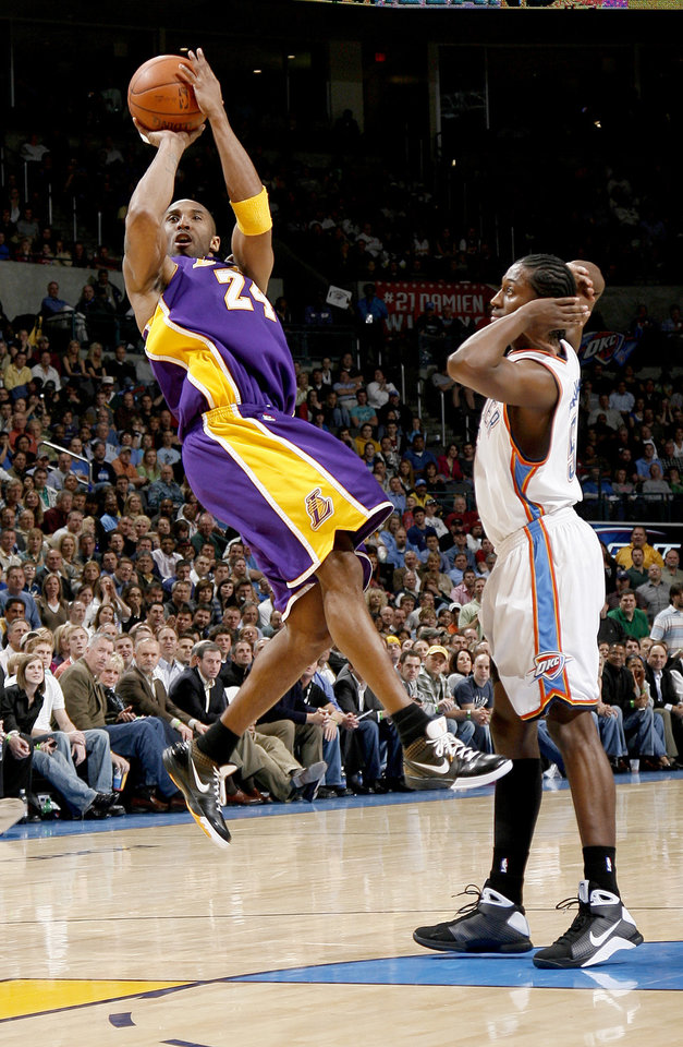 Kobe Bryant of the Lakers shoots the ball as Kyle Weaver of Oklahoma City watches during the NBA basketball game between the Los Angeles Lakers and the Oklahoma City Thunder at the Ford Center,Tuesday, Feb. 24, 2009. The Thunder lost 107-93. PHOTO BY BRYAN TERRY, THE OKLAHOMAN