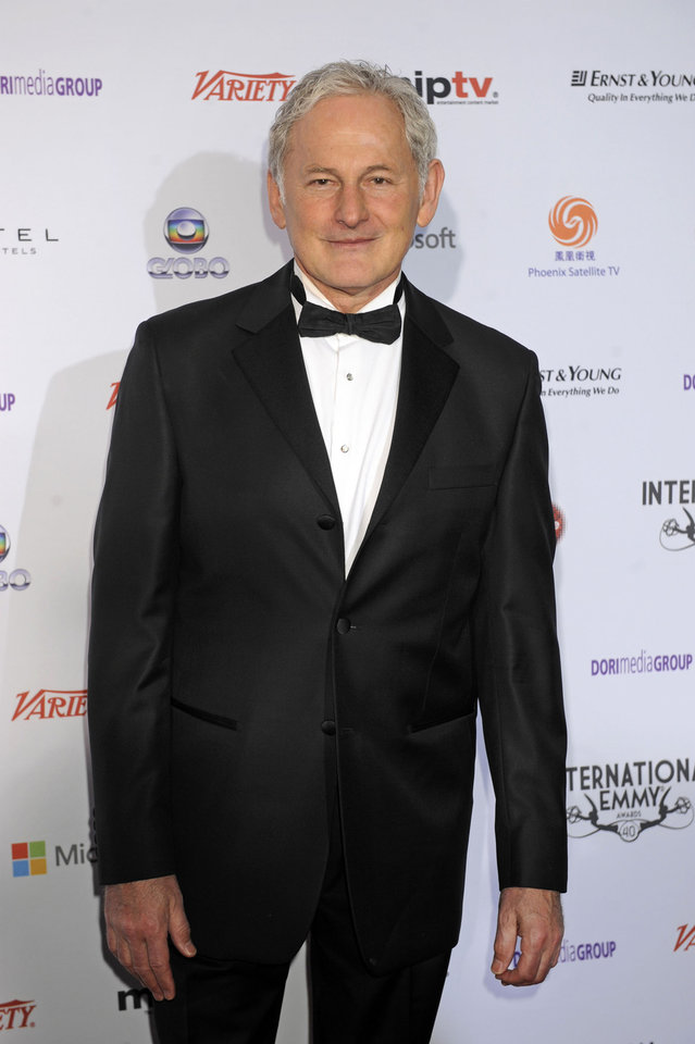 Photo -   Actor Victor Garber arrives at the 40th International Emmy Awards, Monday, Nov. 19, 2012 in New York. (AP Photo/Henny Ray Abrams)