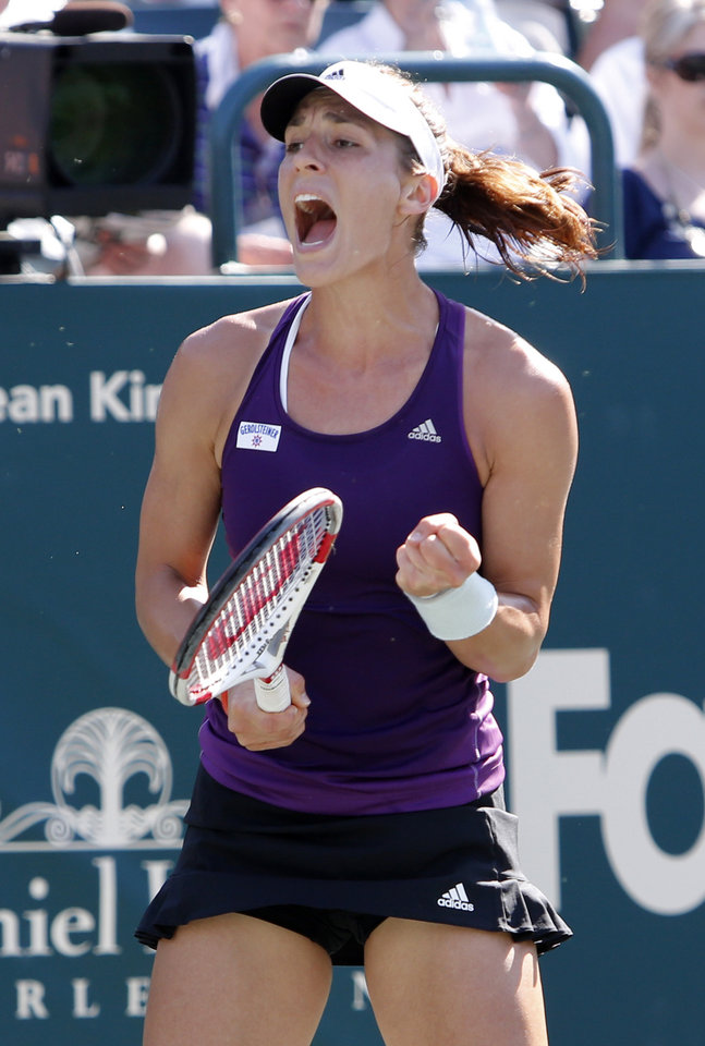 Photo - Andrea Petkovic, of Germany, reacts to Lucie Safarova, of the Czech Republic, during the Family Circle Cup tennis tournament in Charleston, S.C., Friday, April 4, 2014. (AP Photo/Mic Smith)