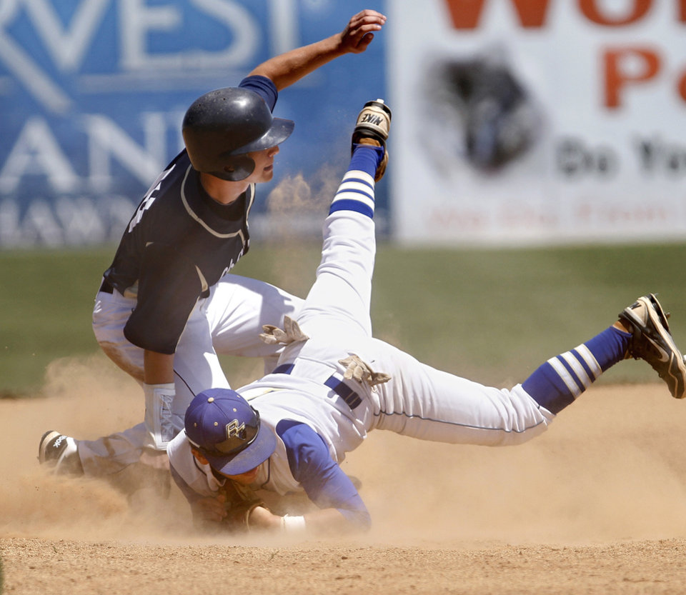 Heritage Hall runner Nathan Bowker slides safely into second base just ahead of the tag by Berryhill shortstop Dyce Applegate during action in the Class 4A state high school baseball tournament at Shawnee High School's Memorial Park. on Thursday,  May 10, 2012.  Beryhill defeated Heritage Hall, 2-1. .    Photo by Jim Beckel, The Oklahoman