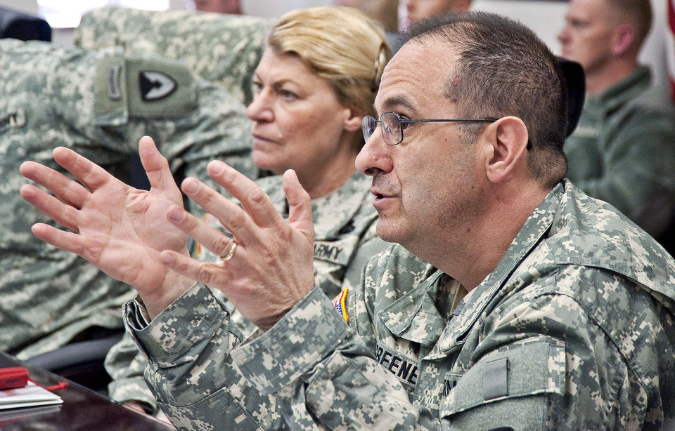 Photo - In this March 3, 2011 photo provided by the U.S. Army, Brig. Gen. Harold Greene, right, speaks beside Gen. Ann Dunwoody at the Natick Soldier Systems Center in Natick, Mass. Maj. Gen. Greene, the two-star Army general who on Tuesday, Aug. 5, 2014, became the highest-ranking U.S. military officer to be killed in either of America's post-9/11 wars, was an engineer who rose through the ranks as an expert in developing and fielding the Army's war materiel. He was on his first deployment to a war zone.(AP Photo/U.S. Army, David Kamm)