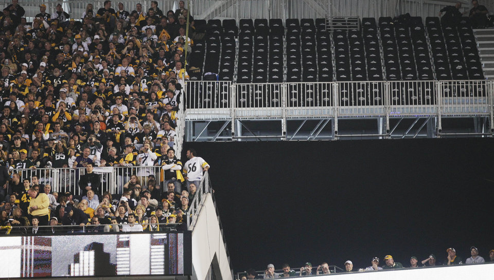 A section of empty seats are seen at Cowboys Stadium before the NFL football Super Bowl XLV  game between the Green Bay Packers and the Pittsburgh Steelers Sunday, Feb. 6, 2011, in Arlington, Texas. The seats were deemed unsafe. (AP Photo/Chris O'Meara)