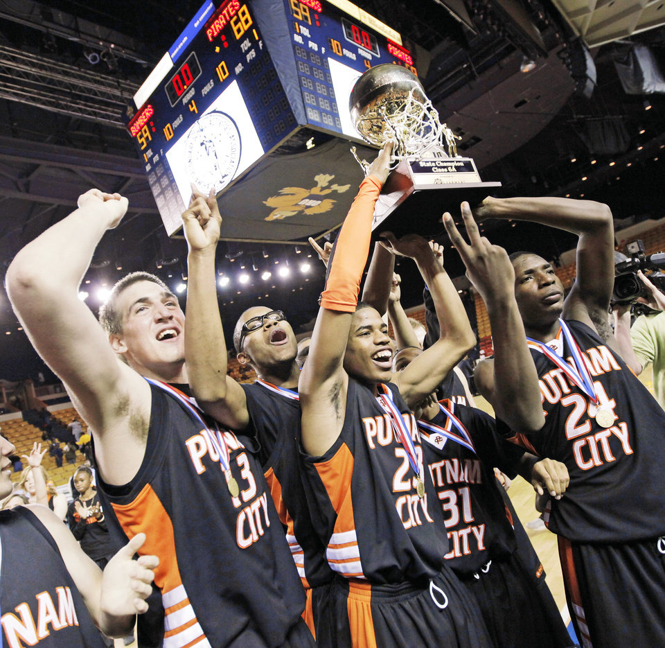 The Putnam City Pirates raise the gold ball championship trophy after their win over Midwest City in the 6A boys title game.  Photo by  Nate Billings,  The Oklahoman
