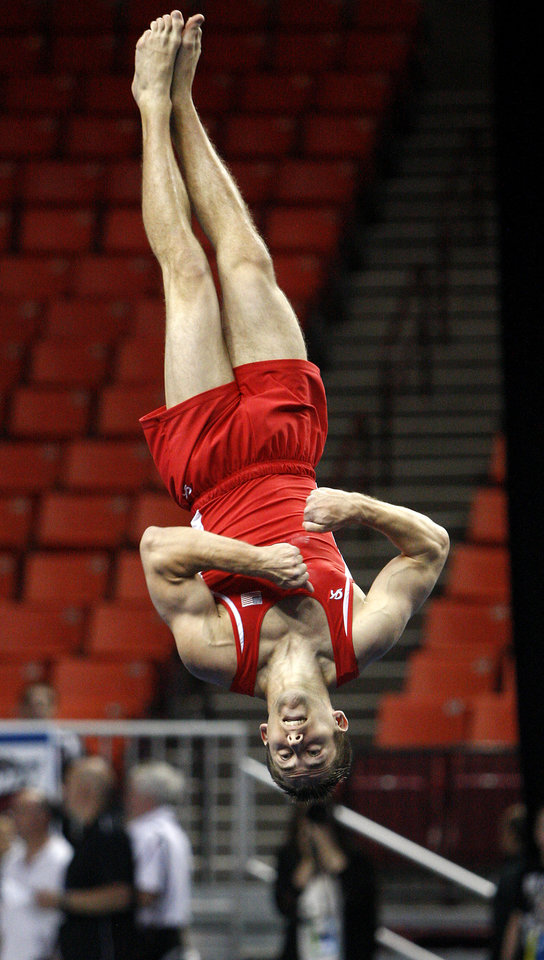Photo - Oklahoma's Chris Stehl competes in the floor exercise during the men's NCAA college gymnastics championships in at the Lloyd Noble Center in Norman, Okla., Thursday, April19, 2012. Photo by Bryan Terry, The Oklahoman