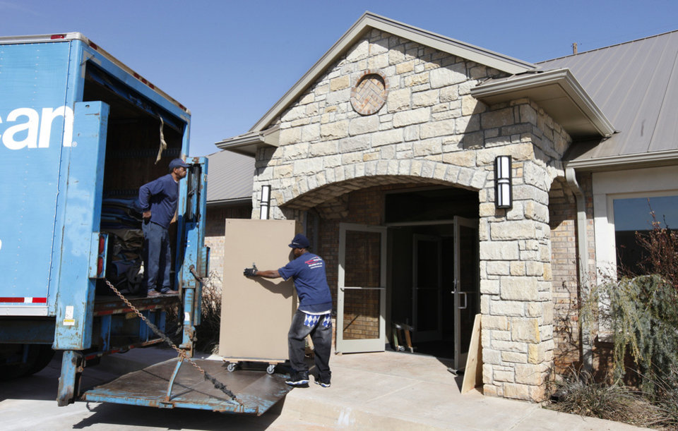 Movers take a file cabinet into Edmond's new information technology building. PHOTO BY PAUL B. SOUTHERLAND, THE OKLAHOMAN. <strong>PAUL B. SOUTHERLAND - THE OKLAHOMAN</strong>