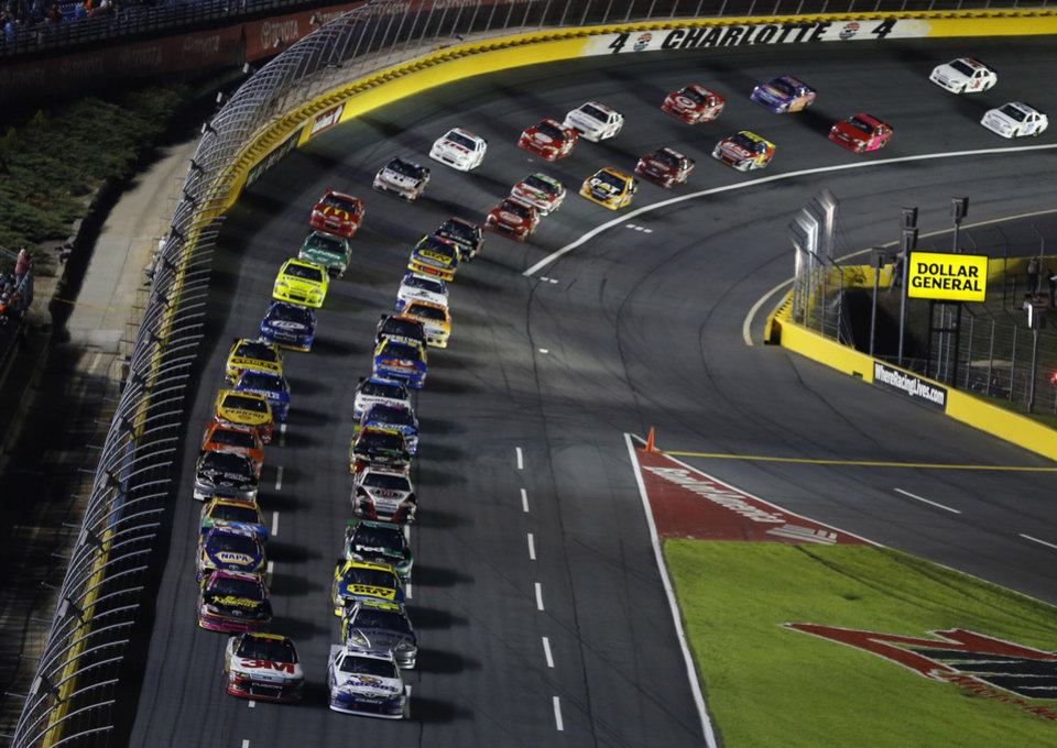 The field heads to the green flag to start the NASCAR Bank of America 500 Sprint Cup series auto race in Concord, N.C., Saturday, Oct. 13, 2012. (AP Photo/Terry Renna)