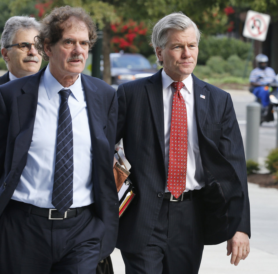 Photo - Former Virginia Gov. Bob McDonnell, right, arrives at federal court with his attorney Henry Asbill in Richmond, Va., Tuesday, Aug. 19, 2014. McDonnell is presenting the second day of his defense on corruption charges. (AP Photo/Steve Helber)