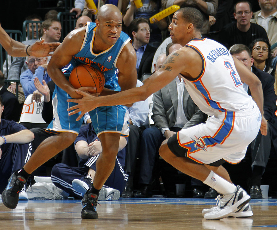 Photo - Oklahoma City Thunder shooting guard Thabo Sefolosha (2) defends New Orleans Hornets point guard Jarrett Jack (2) during the NBA basketball game between the Oklahoma City Thunder and the New Orleans Hornets at the Chesapeake Energy Arena on Wednesday, Jan. 25, 2012, in Oklahoma City, Okla. Photo by Chris Landsberger, The Oklahoman