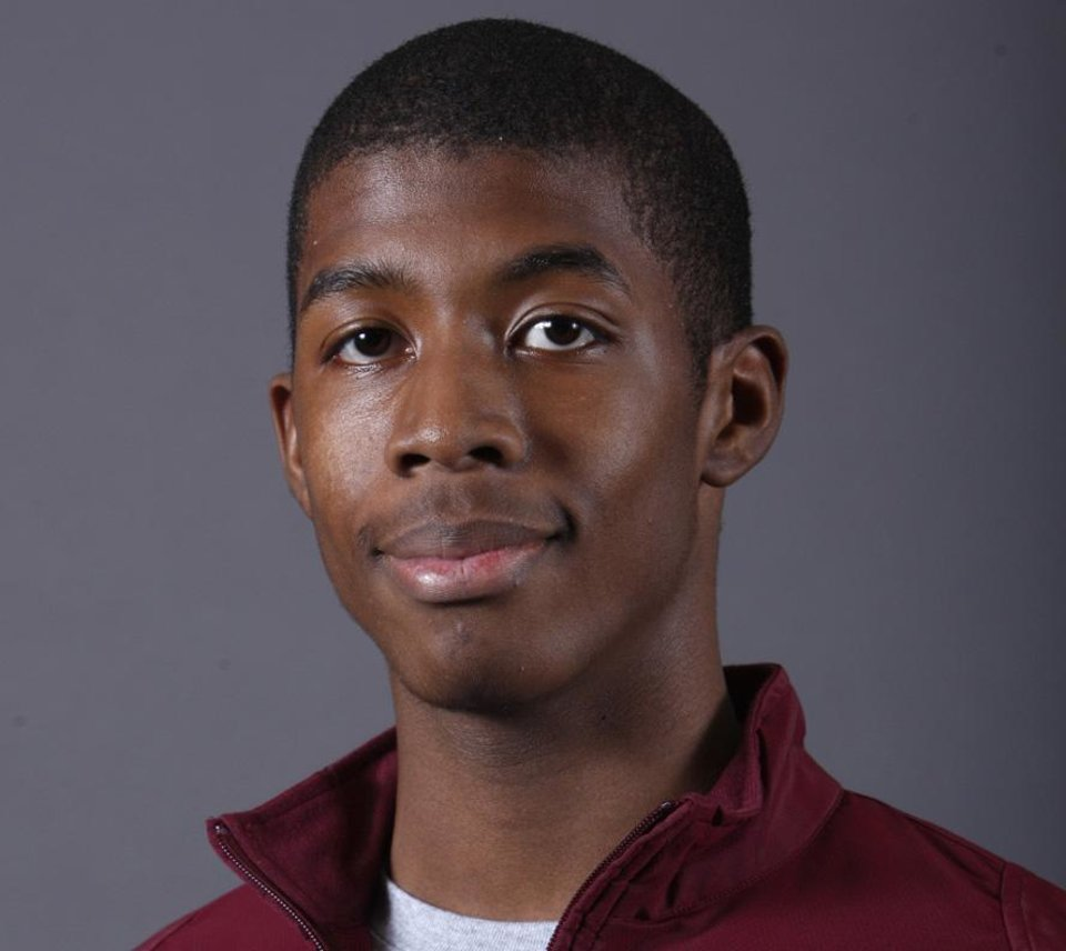 Photo - Isaiah Duke, Edmond Memorial track, poses for a mug during the spring high school sports photo day at the Oklahoman in Oklahoma City, Wednesday, Feb. 16 , 2010.  Photo by Sarah Phipps, The Oklahoman.  ORG XMIT: KOD