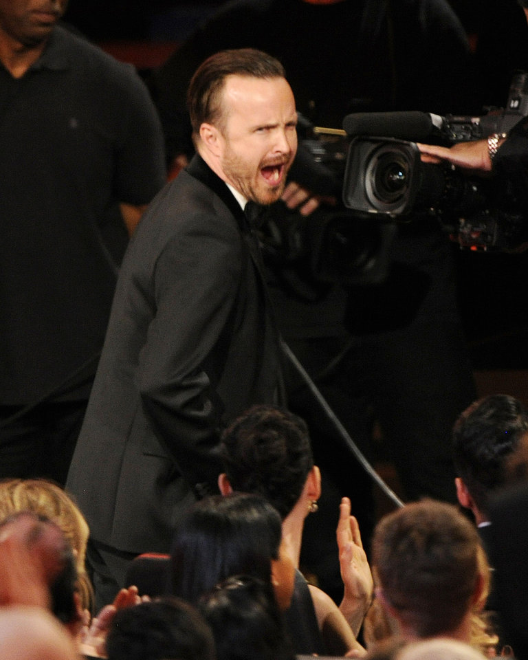 "Photo - Aaron Paul walks to the stage to accept the award for outstanding supporting actor in a drama series for his work on ""Breaking Bad"" at the 66th Annual Primetime Emmy Awards at the Nokia Theatre L.A. Live on Monday, Aug. 25, 2014, in Los Angeles. (Photo by Chris Pizzello/Invision/AP)"