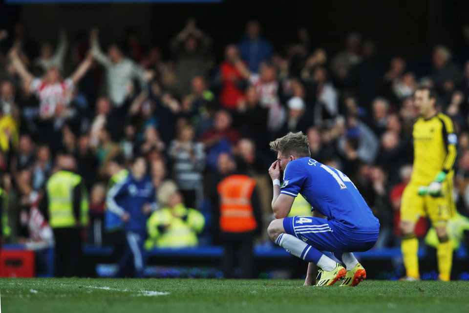 Photo - Chelsea's Andre Schurrle remains on the pitch following the English Premier League soccer match against Sunderland at the Stamford Bridge ground in London, Saturday, April 19, 2014. Sunderland won the match 2-1. (AP Photo/Lefteris Pitarakis)
