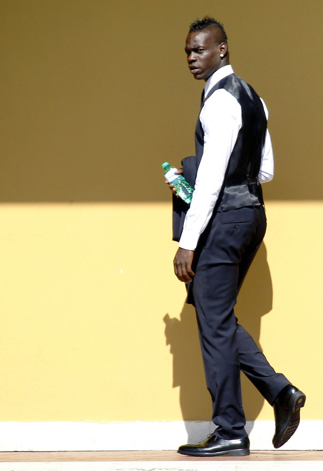 Photo - Italy forward Mario Balotelli, wears the official team suit at the Coverciano center, near Florence, Italy, Tuesday, June 3, 2014. (AP Photo/Fabrizio Giovannozzi)