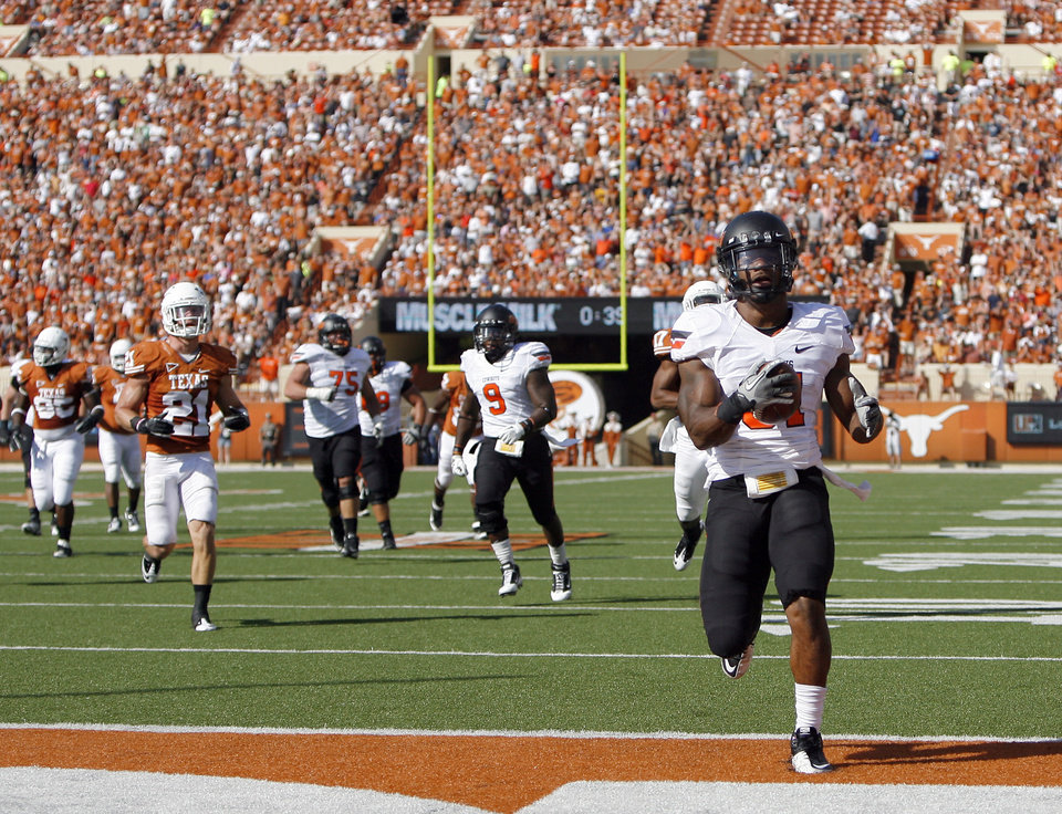 Photo - Oklahoma State's Jeremy Smith (31) scores a touchdown during first half of a college football game between the Oklahoma State University Cowboys (OSU) and the University of Texas Longhorns (UT) at Darrell K Royal-Texas Memorial Stadium in Austin, Texas, Saturday, Oct. 15, 2011. Photo by Sarah Phipps, The Oklahoman