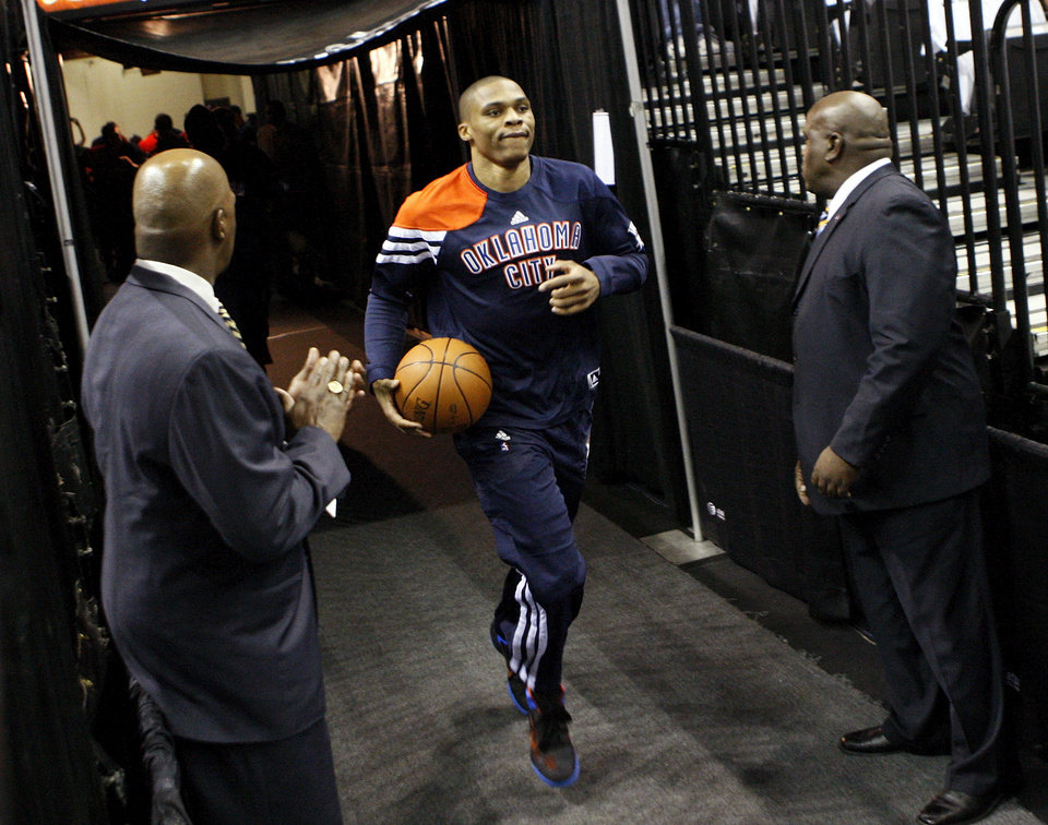 Photo - Oklahoma City's Russell Westbrook (0) leads to team on to the court to warm up before Game 5 of the Western Conference Finals between the Oklahoma City Thunder and the San Antonio Spurs in the NBA basketball playoffs at the AT&T Center in San Antonio, Monday, June 4, 2012. Photo by Nate Billings, The Oklahoman