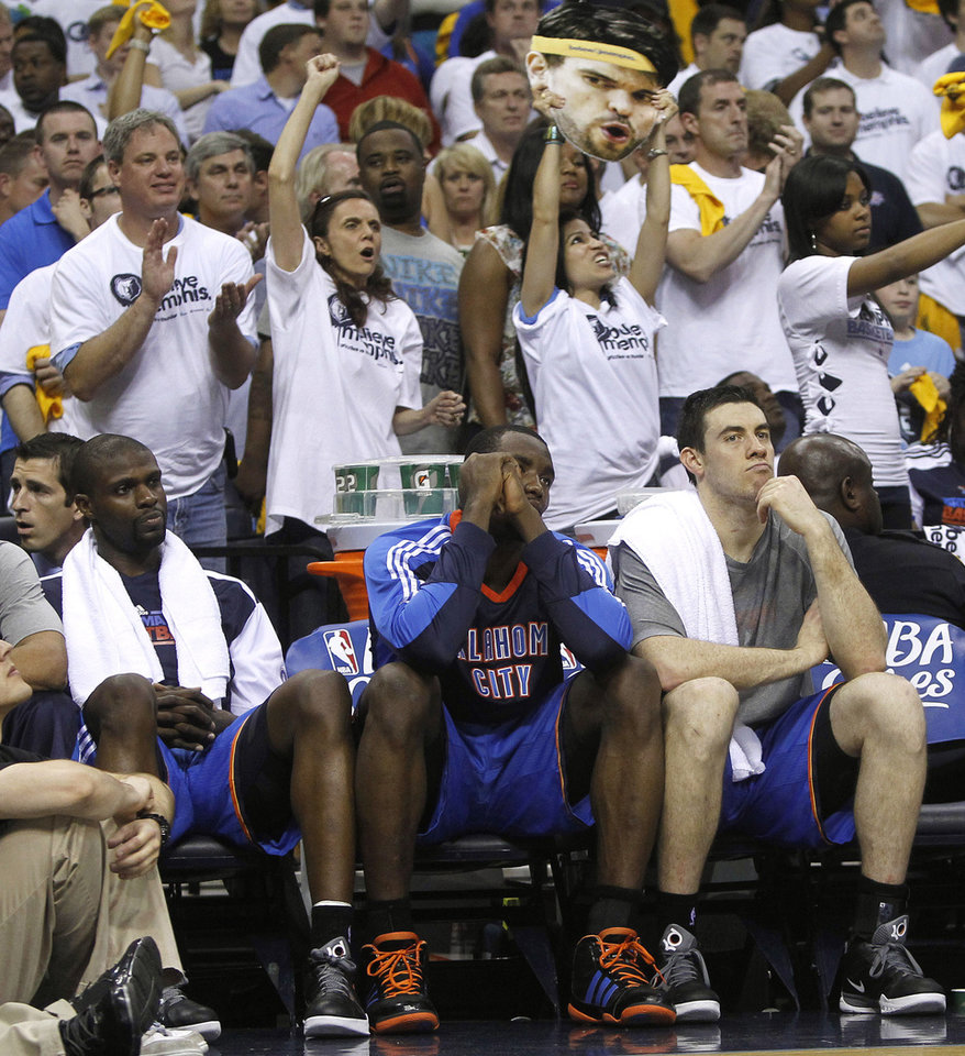 Photo - Memphis Grizzlies fans cheer behind the Oklahoma City Thunder bench during the second half of Game 6 of a second-round NBA basketball playoff series on Friday, May 13, 2011, in Memphis, Tenn. The Grizzlies won 95-83 to even the series 3-3. (AP Photo/Lance Murphey)