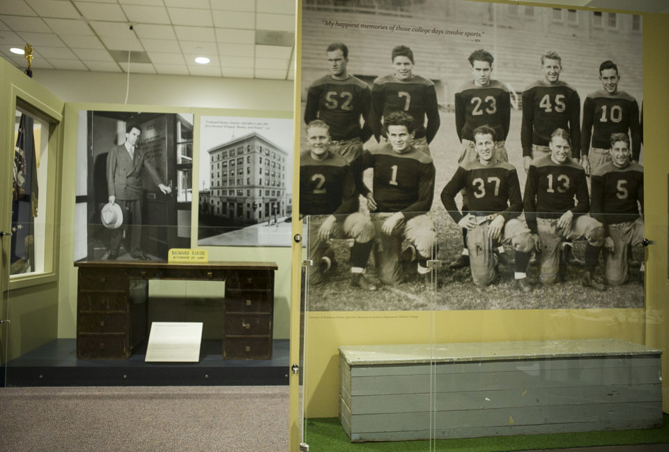 Photo - In this Tuesday, Feb. 12, 2013 photo, President Richard Nixon warms the bench at Whittier College, at right, part of  the new exhibit:
