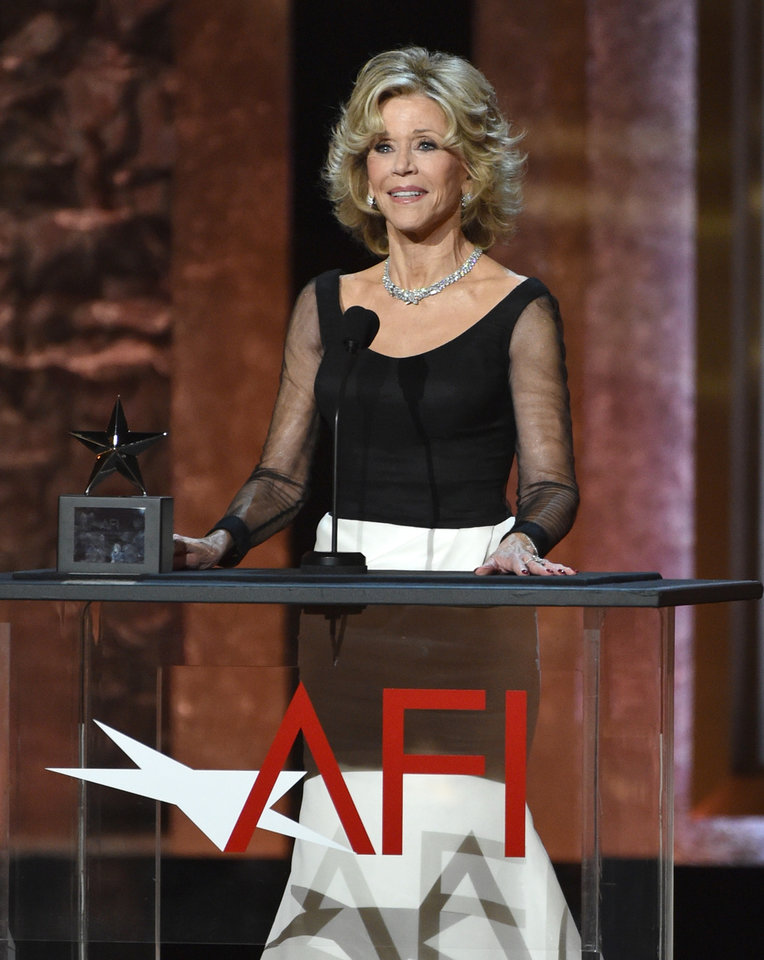 Photo - Jane Fonda accepts the AFI Lifetime Achievement Award at the 42nd AFI Lifetime Achievement Award Tribute Gala at the Dolby Theatre on Thursday, June 5, 2014, in Los Angeles. (Photo by John ShearerInvision/AP)