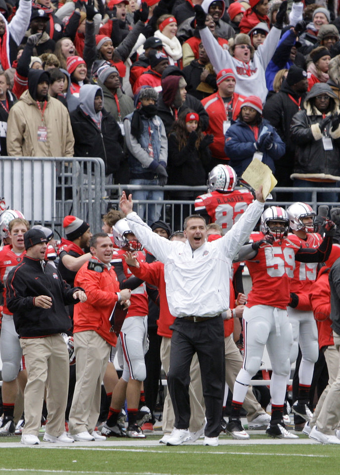 Ohio State head coach Urban Meyer celebrates as time runs off the clock in their 26-21 win over Michigan in an NCAA college football game Saturday, Nov. 24, 2012, in Columbus, Ohio. (AP Photo/Jay LaPrete)