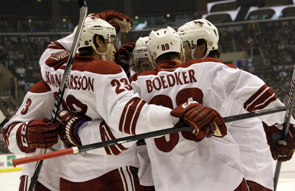 Phoenix Coyotes celebrate their first goal against the Los Angeles Kings in the first period of an NHL hockey game in Los Angeles Monday, March 17, 2014.  (AP Photo/Reed Saxon)