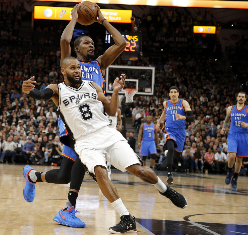 Photo - Oklahoma City's Kevin Durant (35) goes past San Antonio's Patty Mills (8) during Game 2 of the second-round series between the Oklahoma City Thunder and the San Antonio Spurs in the NBA playoffs at the AT&T Center in San Antonio, Monday, May 2, 2016. Photo by Bryan Terry, The Oklahoman
