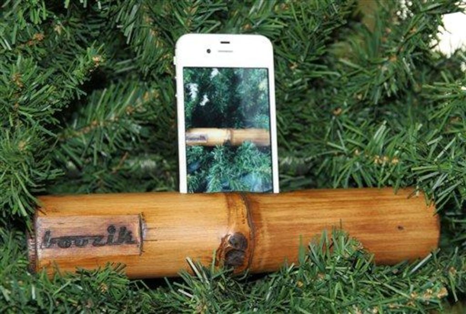 This undated publicity photo provided by GottaLottaHope.com shows a Boozik, an all-natural bamboo port for iPhone 4 and 4s. The 9-inch-long Boozik, with a circumference of 6 inches, is cordless, battery free and comes with a cotton carry case. (AP Photo/GottaLottaHope.com)