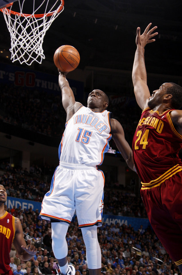 Photo - Oklahoma City's Reggie Jackson (15) goes up for a dunk beside Cleveland's Samardo Samuels (24) during the NBA basketball game between the Oklahoma City Thunder and the Cleveland Cavaliers at Chesapeake Energy Arena in Oklahoma City, Friday, March 9, 2012. Photo by Bryan Terry, The Oklahoman
