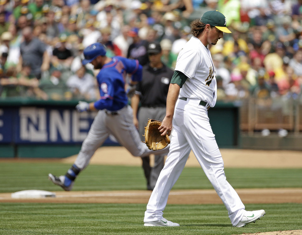 Photo - Oakland Athletics starting pitcher Jeff Samardzija, right, walks back to the mound after giving up a three run homer to the New York Mets' Lucas Duda, left, during the third inning of their interleague baseball game Wednesday, Aug. 20, 2014, in Oakland, Calif. (AP Photo/Eric Risberg)