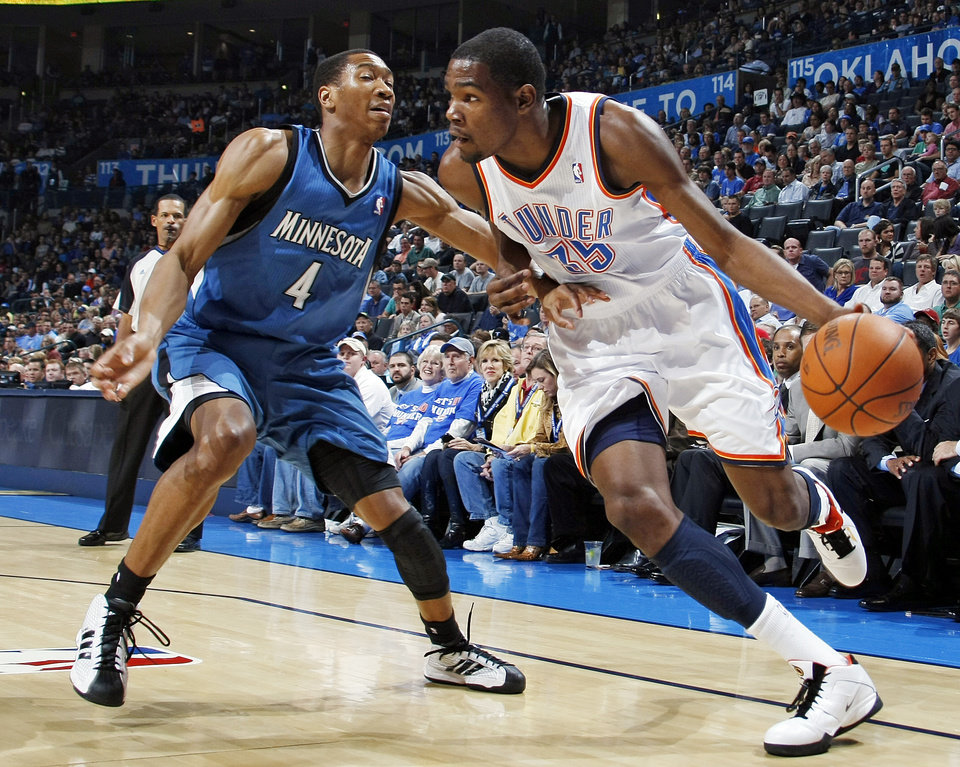 Oklahoma City's Kevin Durant (35) dribbles the ball past Wesley Johnson (4) of Minnesota during the NBA basketball game between the Minnesota Timberwolves and the Oklahoma City Thunder at the Oklahoma City Arena, Monday, November 22, 2010, in Oklahoma City. Photo by Nate Billings, The Oklahoman