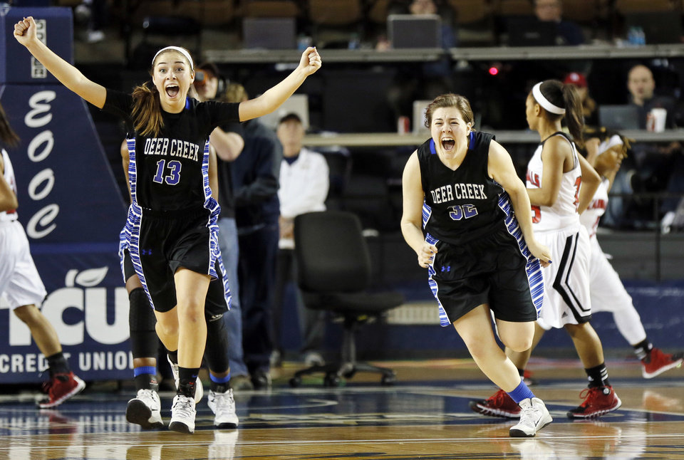Photo - Deer Creek's Whitney Jones (13) and Bayli Blanchard (32) react after winning the Class 5A girls championship game in the state high school basketball tournament against Tulsa East Central at the Mabee Center in Tulsa, Okla., Saturday, March 15, 2014. Deer Creek won, 31-28. Photo by Nate Billings, The Oklahoman