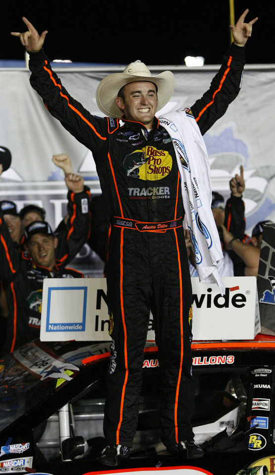 Photo -   Austin Dillon celebrates after winning the NASCAR Nationwide Series auto race at Kentucky Speedway in Sparta, Ky., Friday, June 29, 2012. (AP Photo/James Crisp)