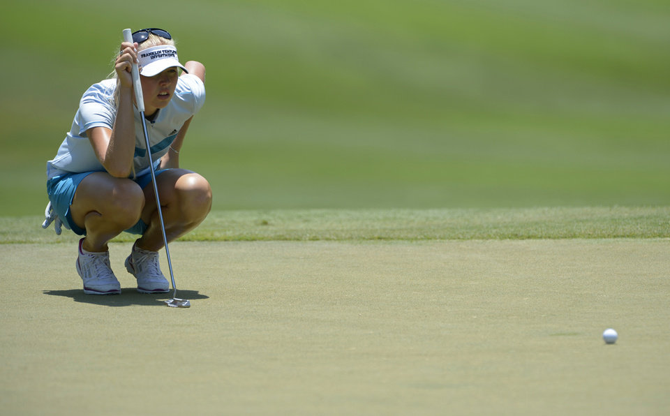 Photo - Jessica Korda lines up a putt on the ninth green during the second round of the Airbus LPGA Classic golf tournament at Magnolia Grove on Friday, May 23, 2014, in Mobile, Ala. (AP Photo/G.M. Andrews)