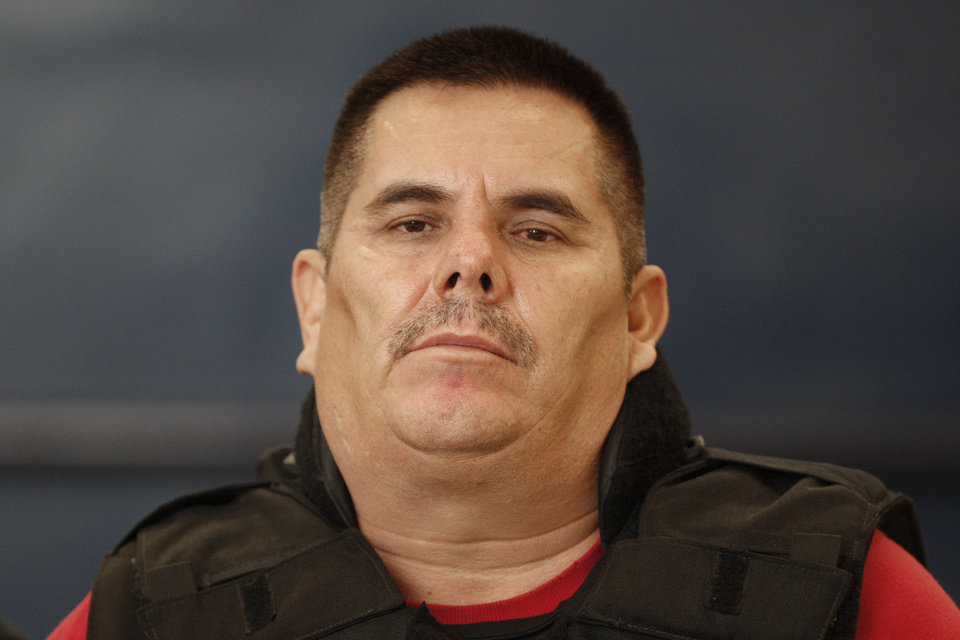 "Jose de Jesus Mendez Vargas, aka, ""El Chango"" or ""The Monkey,"" alleged leader of Mexican La Familia drug cartel, looks on during his presentation to the press in Mexico City, Wednesday, June 22, 2011. Mendez was arrested at a federal police checkpoint in the Mexican central state of Aguascalientes Tuesday, without confrontation or casualties according to authorities. The government had offered a $2.5 million reward for his capture. (AP Photo/Miguel Tovar)"
