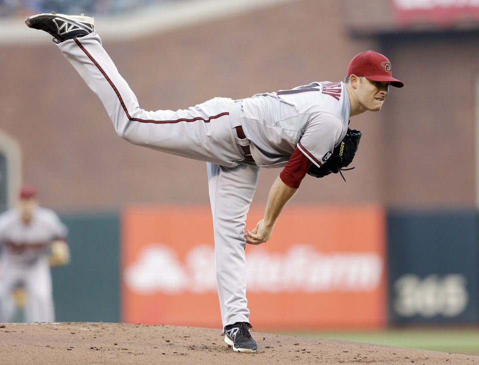 Arizona Diamondbacks starting pitcher Ian Kennedy follows through on a delivery to the San Francisco Giants during the first inning of a baseball game Friday, July 19, 2013, in San Francisco. (AP Photo/Marcio Jose Sanchez)